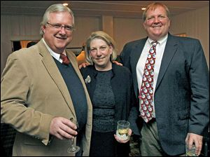 From left: Edward Reams, Kate MacPherson and John Reams attend the holiday dinner at the Carranor Hunt and Polo Club in Perrysburg.
