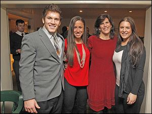 From left: the Morse family - Alex, Meredith, Alex's mom Jill, and Bella, attend the holiday dinner at the Carranor Hunt and Polo Club in Perrysburg. Meredith and Bella are Alex's cousins.