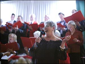 Margot Quick sings a solo during the  Wassasiler's party at Carranor Hunt and Polo Club in Perrysburg.