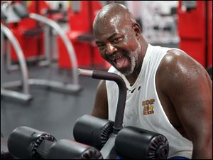Toledo Mayor Mike Bell works out at the Super Fitness Center on North Reynolds Road on Oct. 18 in Toledo.