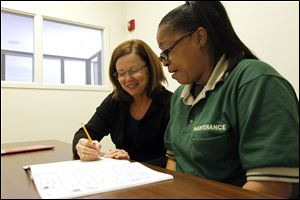 Chrisann Sferra, left, a tutor in the Read for Literacy program, helps Tanya Lucas at the Main Library. Ms. Sferra, a former community college professor, has been volunteering for years.
