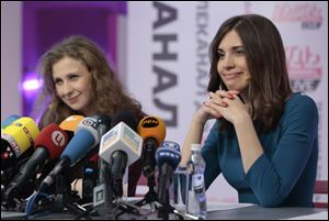 Russian punk band Pussy Riot members Nadezhda Tolokonnikova, right, and Maria Alekhina smile during their news conference Friday in Moscow.