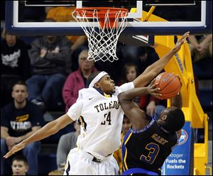 University of Toledo guard J.D. Weatherspoon (24) defends against Coppin State University forward Dallas Gary (3) today.