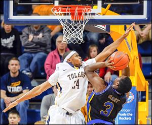Toledo guard J.D. Weatherspoon, who finished with seven points, defends against Coppin State's Dallas Gary in Saturday's game at Savage Arena.  The Rockets (12-0) play Monday at No. 16 Kansas.