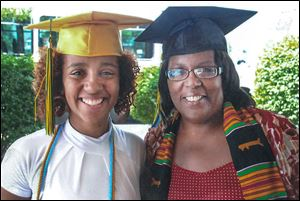 A family photo shows Tracee Ellis, right, and her daughter, Kayla Lindsey, at a joint graduation party in 2008. Ms. Ellis graduated from the University of Toledo in May of that year, and her daughter graduated from Start High School a month later.