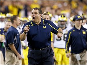Michigan coach Brady Hoke yells at officials during the first half.