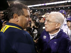 Kansas State head coach Bill Snyder, right, meets with Michigan head coach Brady Hoke as the two talk on the field after the game.