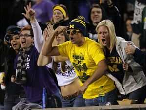 Michigan and Kansas State fans cheer during the second half.