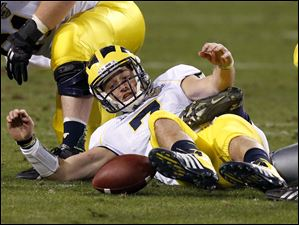 Michigan's Shane Morris fumbles the ball, which he later recovered, during the second half.