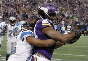 Minnesota Vikings wide receiver Cordarrelle Patterson, right, catches an eight-yard touchdown pass in front of Detroit Lions cornerback Chris Greenwood during the second half on Sunday in Minneapolis.