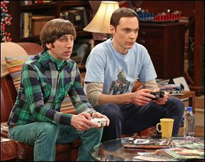 "Jim Parsons, right, and Simon Helberg in a scene from ""The Big Bang Theory,"" one of only two comedies that rank in Nielsen's Top 20."