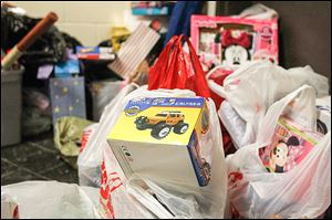 Gifts for central Toledo children pile up during a charity basketball game last month.