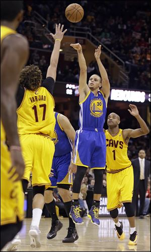 Warriors guard Stephen Curry scored 29 points and made a clutch jumper with 13.5 seconds left as the Golden State opened a long road trip with their fifth straight victory, 108-104 in overtime against the Cleveland Cavaliers on Sunday.