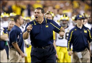 Michigan coach Brady Hoke yells at officials during the first half of the Buffalo Wild Wings Bowl on Saturday night in Tempe, Ariz.