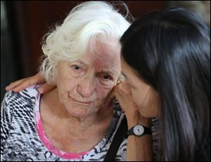Thai caretaker, right, consoles Elizabeth, an Alzheimer patient from Switzerland, at Baan Kamlangchay care center in Chiang Mai province, northern Thailand.