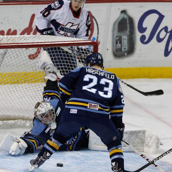 Walleye-goalie-Hannu-Toivonen-gets-help-at-the-n
