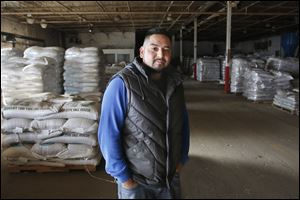 Rojelio 'Roger' Sanchez, who moved to Napoleon for a better life, works as a manager of a seed supply firm.