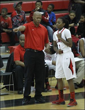 Rogers coach Lamar Smith directs Sasha Dailey. The Rams played some of the nation's top teams this week at a tournament in Naples, Fla.