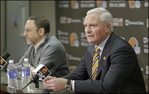 Browns owner Jimmy Haslam, right, answers questions at the Browns training facility as CEO Joe Banner listens. The two men are facing a lot of criticism for firing Rob Chudzinski after one season.