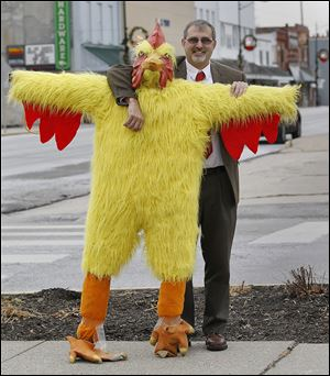 Delta Mayor Dan Miller props up Chuck the Chicken, which will drop in downtown Delta.