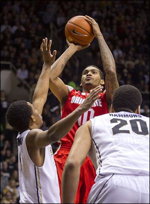 Ohio State's LaQuinton Ross (10) shoots over Purdue's Basil Smotherman (5) in the first half.