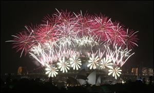 Fireworks explode over the Harbour Bridge and the Opera House during New Year's Eve celebrations in Sydney, Australia.