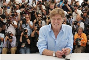 Redford poses for photographers during a photo call for the film