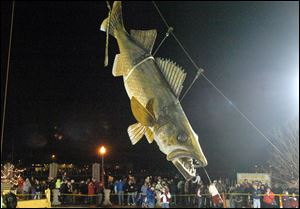 Wylie, a 20-foot long, 600-pound fiberglass walleye, touches down at midnight to welcome 2011 in Port Clinton. This year's festivities will begin at 4 p.m.