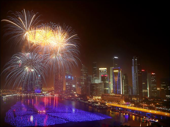 Singapore New Years Eve Fireworks explode over the financial district at midnight, Wednesday in Singapore. Celebrations started on New Year's Eve where concerts were held and thousands gathered on the streets to usher in the Year 2014.