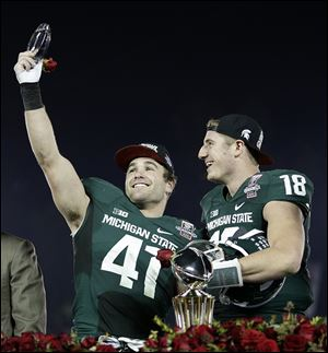 Michigan State linebacker Kyler Elsworth, left, celebrates with QB Connor Cook. Elsworth filled in for suspended LB Max Bullough.