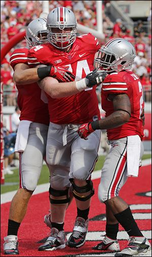 Jack Mewhort, center, helped OSU to the third-best rushing attack in the nation this season.