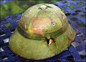 Damaged and dented, this North Vietnamese helmet that John Wast found on a battlefield in 1968 reminds him of his service in Vietnam. Markings inside helped locate the slain soldier's family.