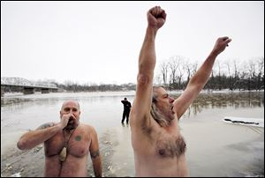 Mike Hill, left, of Waterville and Bob Scott of Luckey, Ohio, pump up the crowd for the plunge into the icy river.