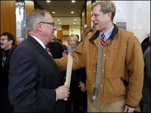 D. Michael Collins, left, speaks with Lucas County Republican party chairman Jon Stainbrook.