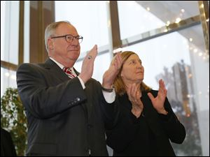 D. Michael Collins and his wife Sandra Drabik, applaud while waiting in the wings before taking the Oath of Office for the Mayor of Toledo.