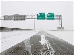 I-75 Southbound is clear of traffic during a level 2 snow emergency although a path is worn in the middle of the highway.