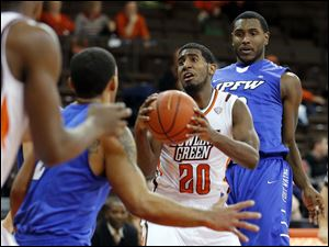 Bowling Green guard Jehvon Clarke (20) looks for an opening.