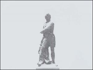 The Commodore Perry statue on Louisiana Avenue in Perrysburg is covered with snow.