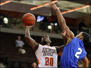 Bowling Green State University guard Jehvon Clarke (20) shoots against  IPFW guard Pierre Bland (2).