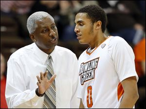 Bowling Green State University head coach Louis Orr gives instructions to center Josh Gomez.