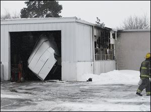 A fire in Fulton County caused smoke damage to one Pike-Delta-York school bus and damaged the district's maintenance garage.
