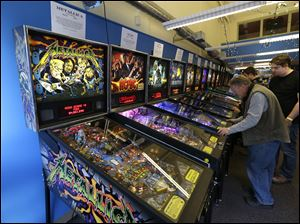 Visitors play pinball on more modern machines at the Seattle Pinball Museum in Seattle.