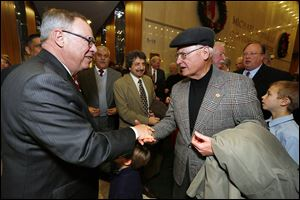 Toledo Mayor D. Michael Collins, left, speaks with former Mayor Carty Finkbeiner. Mr. Finkbeiner was part of Mr. Collins' transition team.