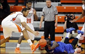 Bowling Green State University forward Cameron Black (35) chases a loose ball against IPFW forward Steve Forbes (54).