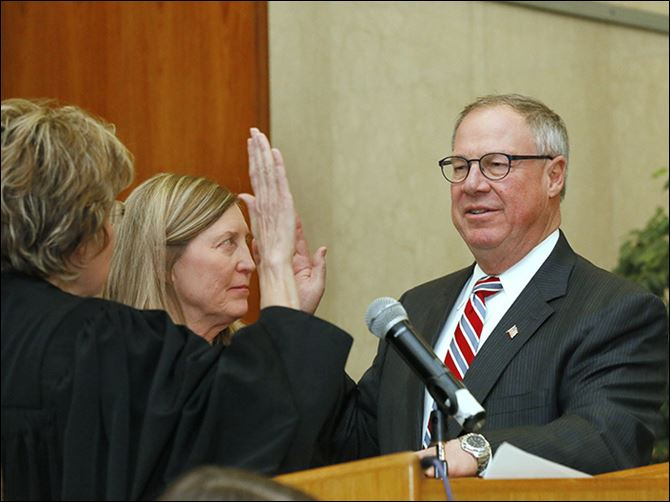 30n6oath Mayor D. Michael Collins takes the oath of office from Judge Ruth Ann Franks of Lucas County Common Pleas Court. Mr. Collins admitted before a crowd of about 200 people he was 'nervous' and 'numb.'
