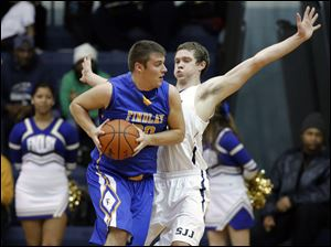 St. John's Trevor Walsh (22) defends against Findlay's Austin Gutting (30).