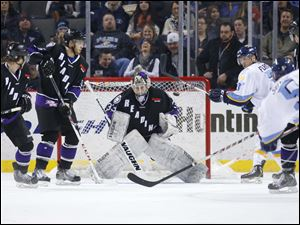 Reading Royals goalie Brandon Anderson (33) stops a shot by Toledo Walleye player Joe Sova (5) during the second period.