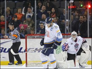 Toledo Walleye player Kyle Rogers (17) and goalie Hannu Toivonen (30) react after the Reading Royals score a goal.