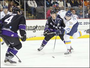Toledo Walleye player Marek Tvrdon (15) shoots the puck past Reading Royals player Marvin Degon (4) for a goal.