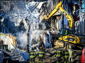 Investigators search for victims in Minneapolis after an apartment blaze on New Year's Day.